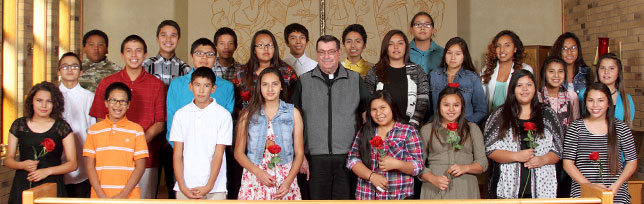 St. Joseph's Indian School's eighth-grade class poses for a photo in the Our Lady of the Sioux Chapel at St. Joseph's in Chamberlain, South Dakota.
