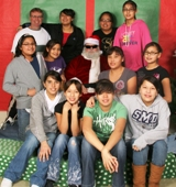 Girls in the Stevens Home have their photo <br/>taken with Santa!