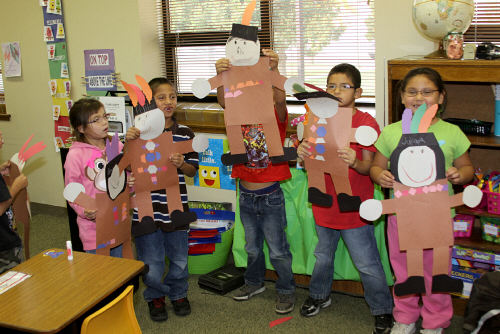 Lakota students work on an art project for Native American Day.