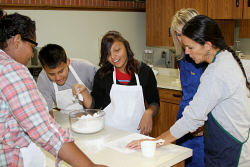 Lakota students making fry bread.