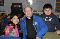 Fr. Steve and St. Joseph's dedicated staff help give the Lakota boys and girls a solid education so they can build a bright future.