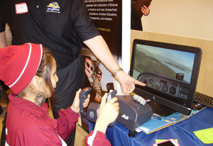 Lakota student flying a virtual airplane.