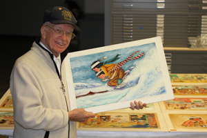 Peter Paul shows off one of his pieces of art work.