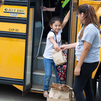 Lakota students exiting the bus.